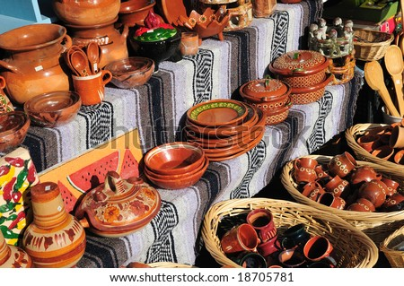Outdoor market stall selling Mexican pottery - stock photo
