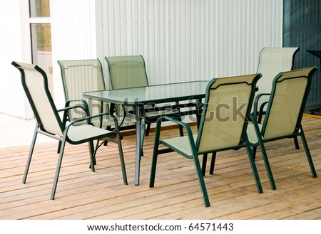 Outdoor, modern patio furniture-table and chairs. - stock photo