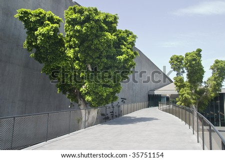 outdoor of a modern building qith a balustrade and trees - stock photo