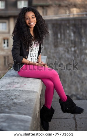 Outdoor of a  portrait beautiful young african american teenage girl - stock photo
