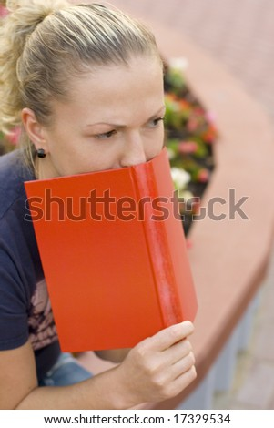 outdoor outdoor portrait of woman with red book