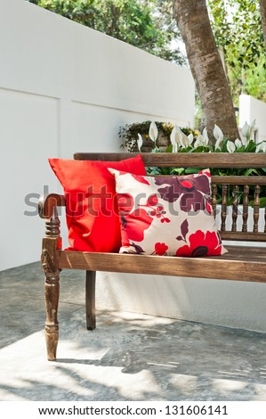 Outdoor patio seating area with nice bench at sunset - stock photo
