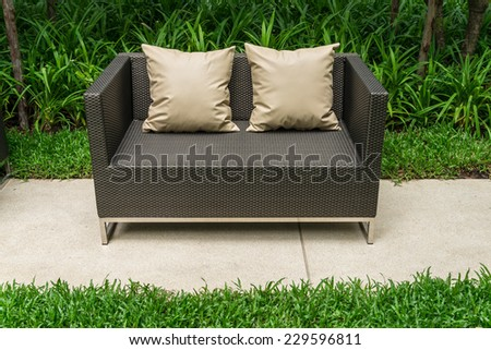 Outdoor patio seating area with Rattan sofa - stock photo