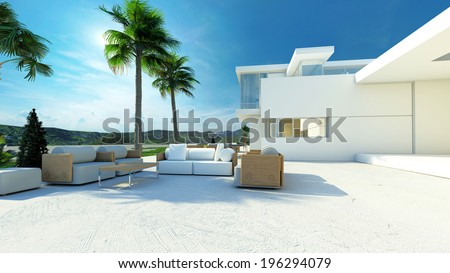Outdoor paved patio living area with comfortable furniture in the shade of palm trees in a modern tropical luxury villa with white walls - stock photo