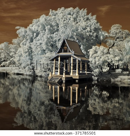 Outdoor Pavilion in the park and view the reflection of water , taken in Near Infrared - stock photo