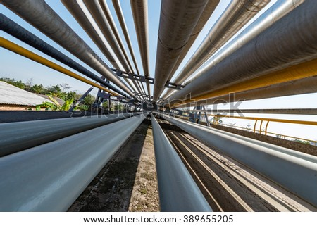 Outdoor pipelines in the refinery - stock photo