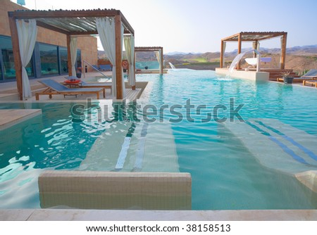Outdoor Pool Spa with Pergolas in a Luxury hotel