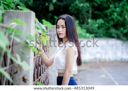 outdoor portrait asian girl with perfect smile and white teeth in the park