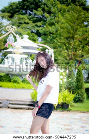 outdoor portrait  asian girl  with perfect smile at the park
