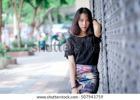 outdoor portrait  asian girl  with perfect smile at the park ,street concept