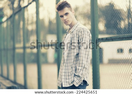 Outdoor portrait handsome man model with deep look in urban style, street fashion, vintage photo - stock photo