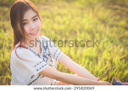 Outdoor portrait of a beautiful asian girl vintage and retro tone, soft focus. - stock photo