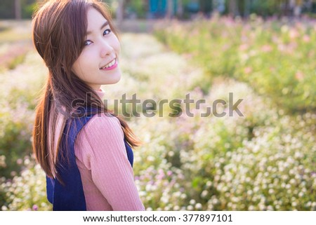 Outdoor portrait of a beautiful asian girl vintage tone - stock photo