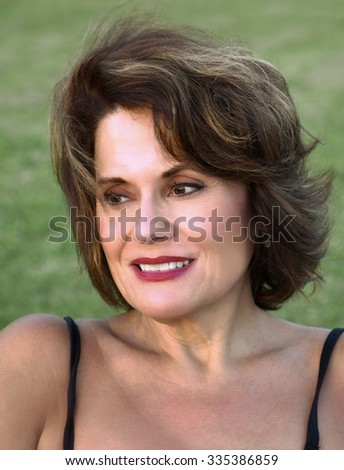 Outdoor Portrait of a Beautiful Mature Woman