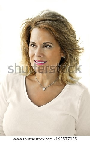 Outdoor Portrait of a Beautiful Mature Woman wearing a White Top  - stock photo