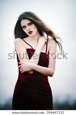 Outdoor portrait of a beautiful sad young woman - stock photo