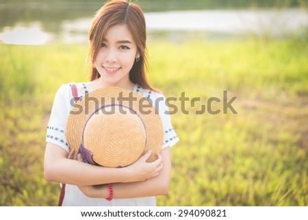 Outdoor portrait of a beautiful teenage asian girl vintage and retro tone, soft focus. - stock photo
