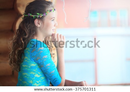 outdoor portrait of a beautiful woman in blue dress  - stock photo