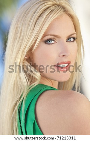 Outdoor portrait of a beautiful young blond woman in her thirties - stock photo