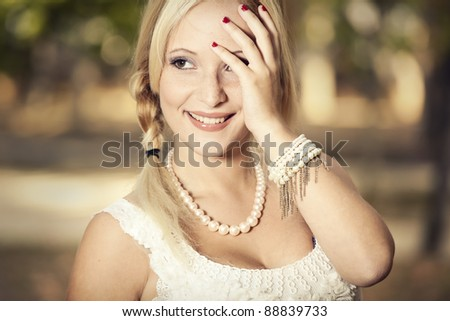 Outdoor portrait of a beautiful young girl laughing - stock photo
