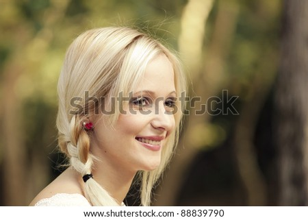 Outdoor portrait of a beautiful young girl smiling - stock photo