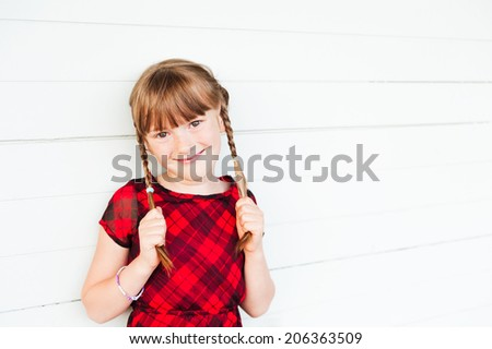 Outdoor portrait of a cute little girl against white background - stock photo