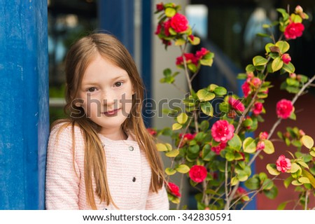 Outdoor portrait of a cute little girl of 7 years old - stock photo
