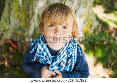 Outdoor portrait of a cute toddler boy - stock photo
