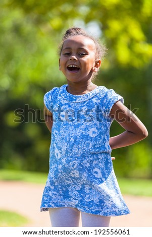 Outdoor  portrait of a cute young black girl smiling - African people - stock photo
