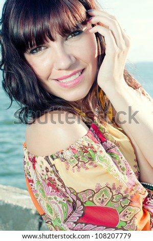 Outdoor portrait of a fresh and lovely woman with luxury hair - stock photo