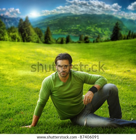 Outdoor portrait of a good looking man in scenic natural setting - stock photo