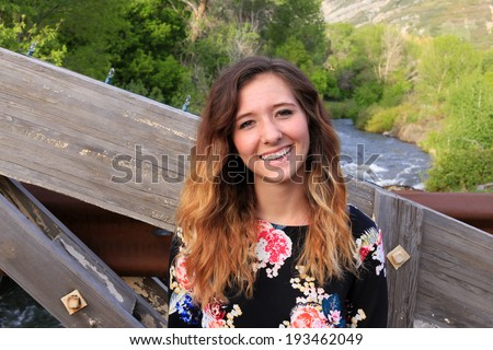Outdoor portrait of a happy young woman smiling. - stock photo