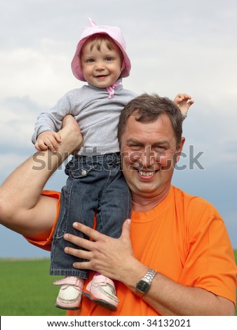 Outdoor portrait of a little girl with her grandfather - stock photo