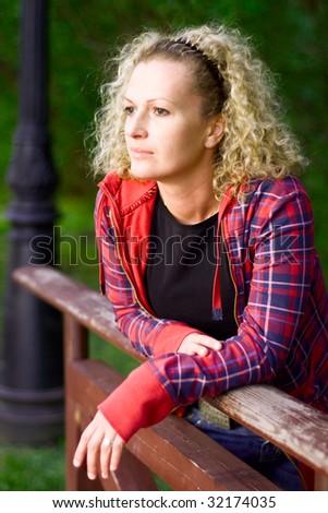 outdoor portrait of a sad woman - stock photo