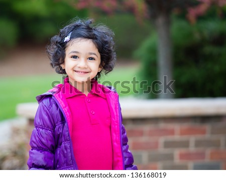 Outdoor Portrait of a Smiling Toddler Girl - stock photo