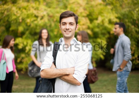 Outdoor portrait of a smiling young man - stock photo