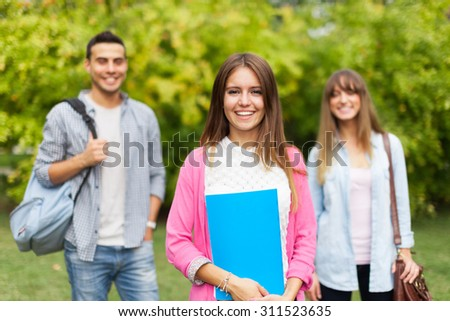 Outdoor portrait of a smiling young woman - stock photo