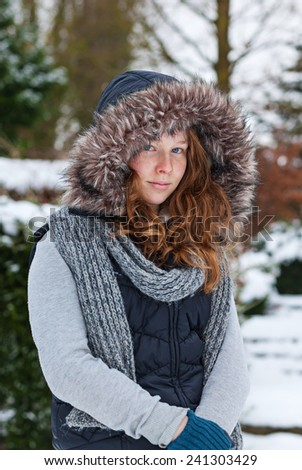 Outdoor portrait of a teenager girl in winter cloths - stock photo