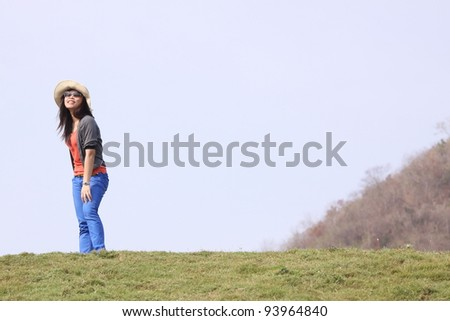 Outdoor portrait of a young asian woman - stock photo
