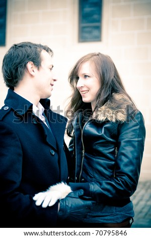 Outdoor portrait of a young couple in love, soft blue tint - stock photo