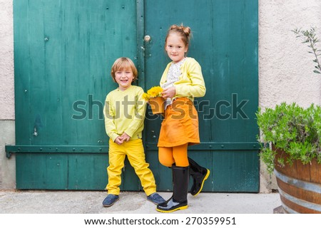 Outdoor portrait of adorable fashion kids, wearing yellow clothes - stock photo