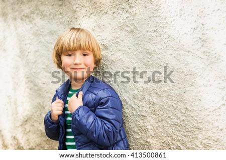 Outdoor portrait of adorable little blond boy wearing blue jacket - stock photo