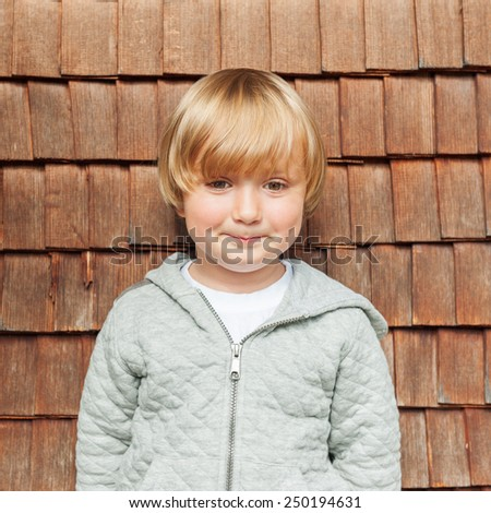 Outdoor portrait of adorable little boy  - stock photo