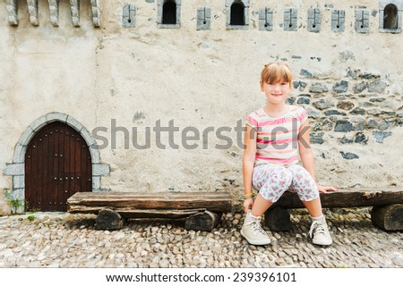 Outdoor portrait of adorable little girl playing in a park on a nice sunny day - stock photo