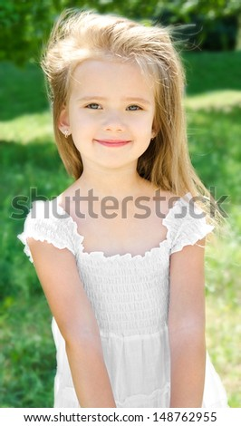 Outdoor portrait of adorable smiling little girl in summer day - stock photo