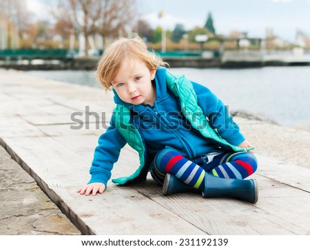 Outdoor portrait of adorable toddler girl - stock photo
