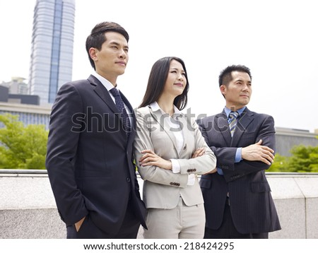 outdoor portrait of an asian business team. - stock photo