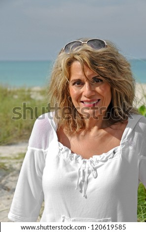 Outdoor Portrait of an Attractive Middle Aged Woman - stock photo