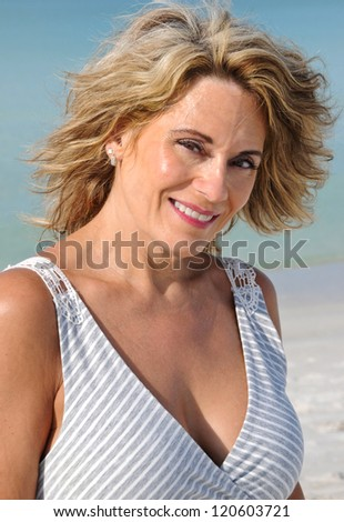 Outdoor Portrait of an Attractive Woman in a Sundress - stock photo