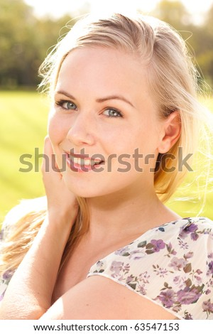 Outdoor portrait of attractive lady - stock photo